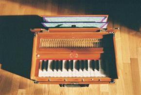 Shoe-box-sized mythical looking Harmonium
